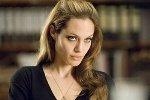 Джоли в коже и перьях для русского Tatler