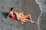 Ирина Шейк и Брэдли Купер устроили разврат на пляже